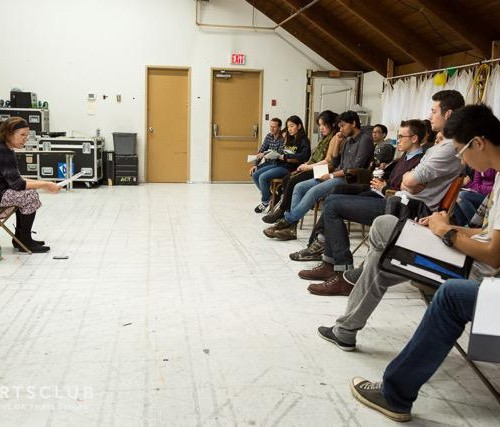 Leanna Brodie giving a talk in front of a group of young theatre artists