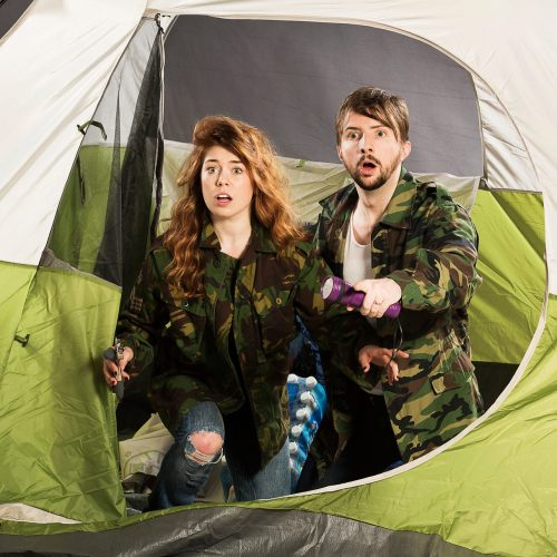 Claire Hesselgrave and Sebastien Archibald in tent with flat of water bottles, in Jordan Hall's