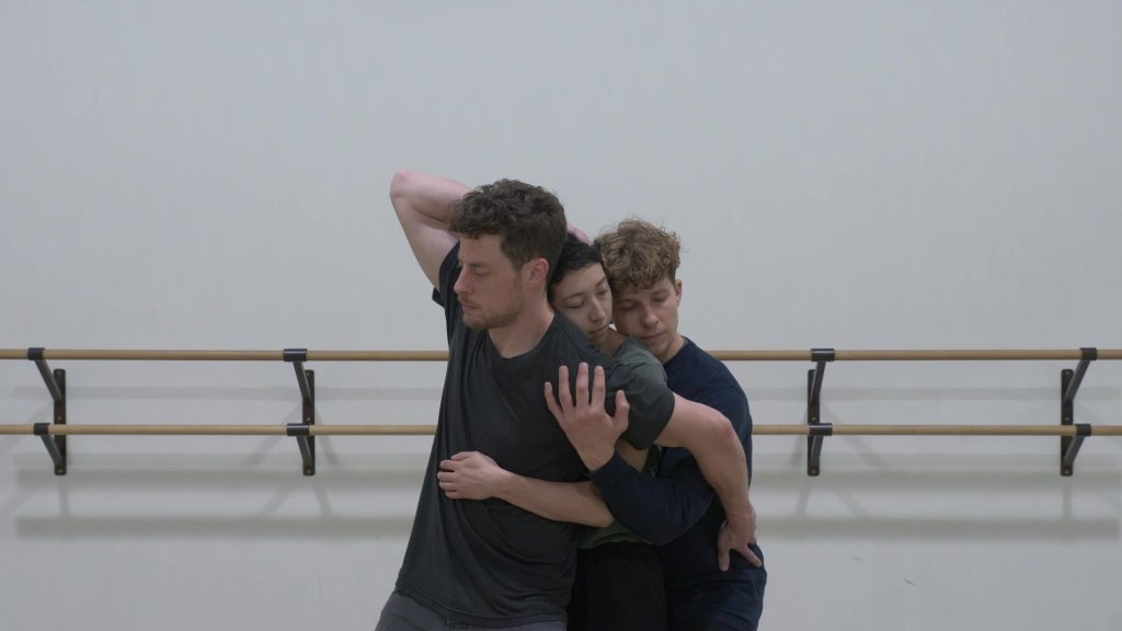 Isak Enquist, Katie Cassady, and Josh Martin dancing in an embrace in How to Say Goodbye
