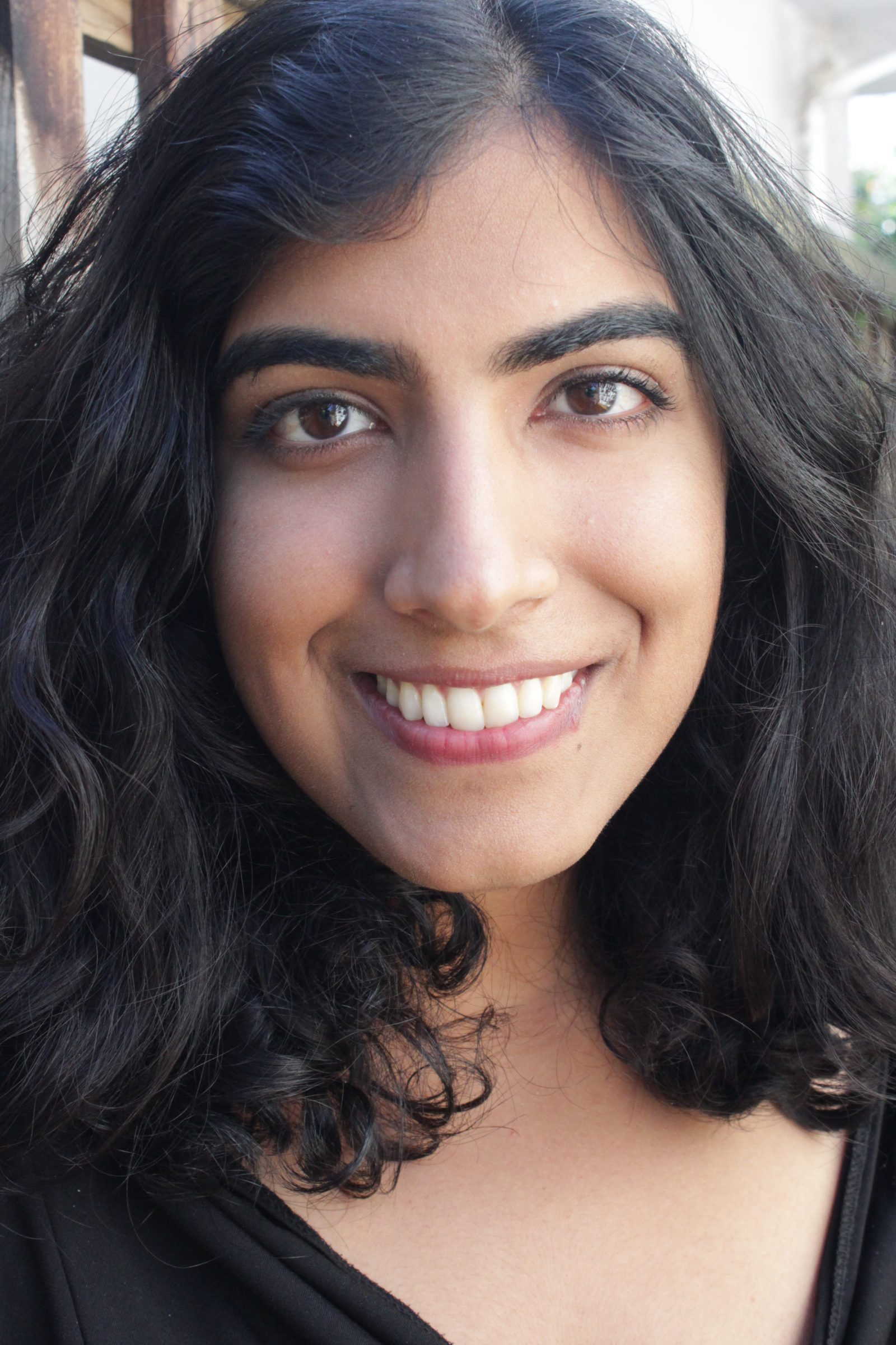 Image of Zahida Rahemtulla: Woman of South Asian descent with shoulder-lenght black hair, brown eyes and bright smile